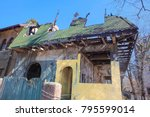 house with roof destroyed after ... | Shutterstock . vector #795599014