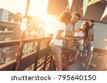 friends having fun at rooftop... | Shutterstock . vector #795640150
