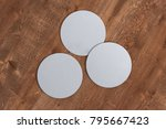 three round white coasters on... | Shutterstock . vector #795667423