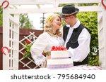 young bride and groom wearing... | Shutterstock . vector #795684940