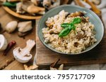 risotto with mushrooms on an...   Shutterstock . vector #795717709