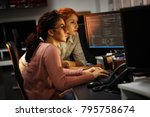 two female programmers working... | Shutterstock . vector #795758674