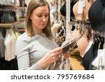 woman choosing bra in clothing... | Shutterstock . vector #795769684