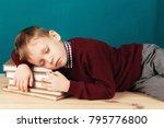 tired school boy asleep on... | Shutterstock . vector #795776800