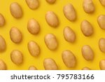 Potato on a colored background. ...