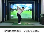A  Man Enjoying Screen Golf...