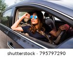 asian woman driving on the car... | Shutterstock . vector #795797290