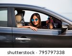 asian woman driving on the car... | Shutterstock . vector #795797338