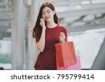 young asian girl with shopping... | Shutterstock . vector #795799414