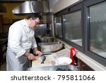 cook preparing salmon to be... | Shutterstock . vector #795811066
