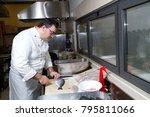 cook preparing salmon to be... | Shutterstock . vector #795811066