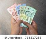 thai banknote money in hand ...   Shutterstock . vector #795817258