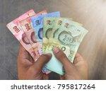 thai banknote money in hand ...   Shutterstock . vector #795817264