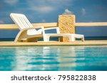 empty white plastic sunbed next ... | Shutterstock . vector #795822838