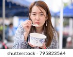 lady with hot breakfast blowing ... | Shutterstock . vector #795823564