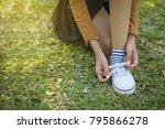 asian young girl tying her... | Shutterstock . vector #795866278