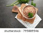 bowl of tasty buckwheat... | Shutterstock . vector #795889546