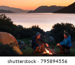 couple camping with campfire...   Shutterstock . vector #795894556