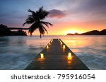 jetty beach at sunset with... | Shutterstock . vector #795916054