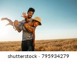 father swinging his daughter in ... | Shutterstock . vector #795934279