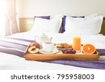 Stock photo breakfast served in bed on wooden tray with tea juice cookies and fruit hotel room service 795958003