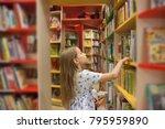 pretty school girl in library... | Shutterstock . vector #795959890