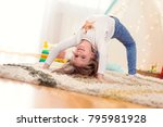 Cheerful Little Girl Doing...