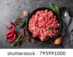 Small photo of Mince. Ground meat with ingredients for cooking on black background. Top view