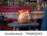 tip jar tipping clay pottery...   Shutterstock . vector #796002043