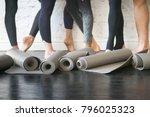 yoga mats in a roll. rubber... | Shutterstock . vector #796025323