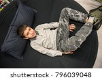 Boy Lying In The Big Round...