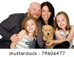 Portrait of a happy family in front of an isolated white background - stock photo