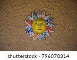 sun sculpture on stucco wall...   Shutterstock . vector #796070314