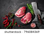 raw pork meat. fresh steaks on... | Shutterstock . vector #796084369