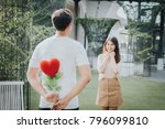 Man Holding Heart Shape Flower...