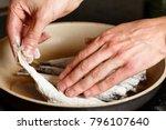fresh smelt  fried in hot oil... | Shutterstock . vector #796107640
