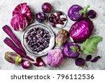 raw purple vegetables over gray ... | Shutterstock . vector #796112536