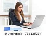 woman using a laptop in her... | Shutterstock . vector #796125214