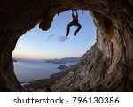 young woman climbing on ceiling ... | Shutterstock . vector #796130386