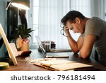 man stressed while working on... | Shutterstock . vector #796181494