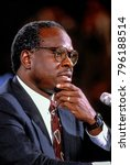 Small photo of Washington DC., USA, 10th September,1991 Clarence Thomas nominee for Associate Justice of the United States Supreme Court ponders questions from the Senate Judiciary Committee during his confirmation