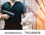 warehouse worker hand holding... | Shutterstock . vector #796188838