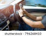man using phone while driving... | Shutterstock . vector #796268410