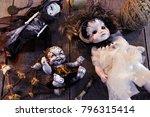three scary dolls on wooden... | Shutterstock . vector #796315414