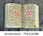 open magic book with evil... | Shutterstock . vector #796316488