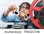 a woman technician cleaning a... | Shutterstock . vector #796321738