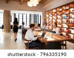 colleagues working at desks in... | Shutterstock . vector #796335190