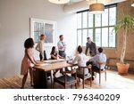 young professionals around a... | Shutterstock . vector #796340209