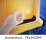close up hand putting empty... | Shutterstock . vector #796342390
