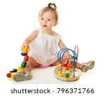 a beautiful baby girl playing...   Shutterstock . vector #796371766